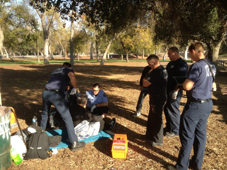 injured homeless man in park