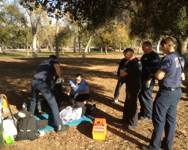 injured homeless man in park
