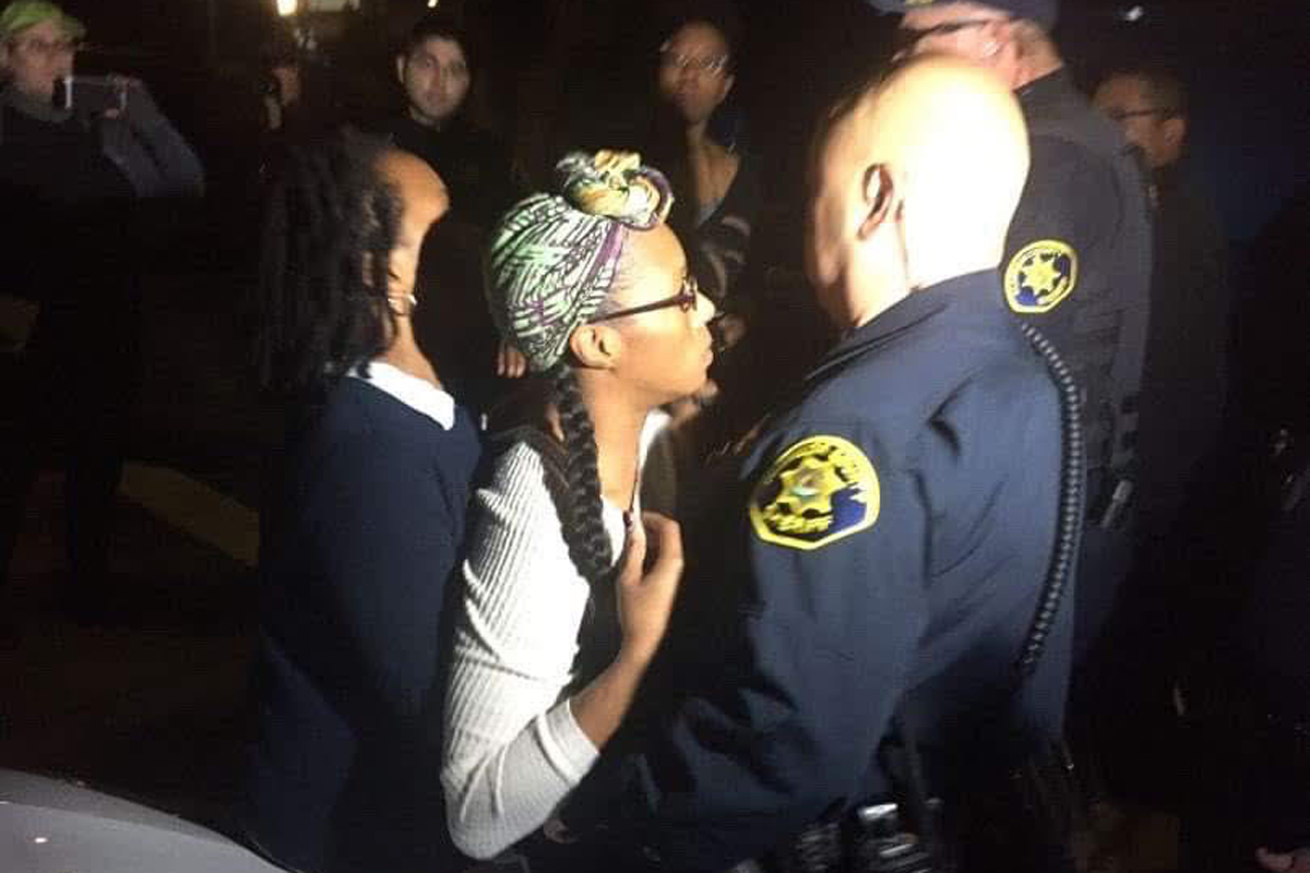 The crowd reacts to homeless mothers being arrested
