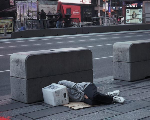 Person sleeping on street