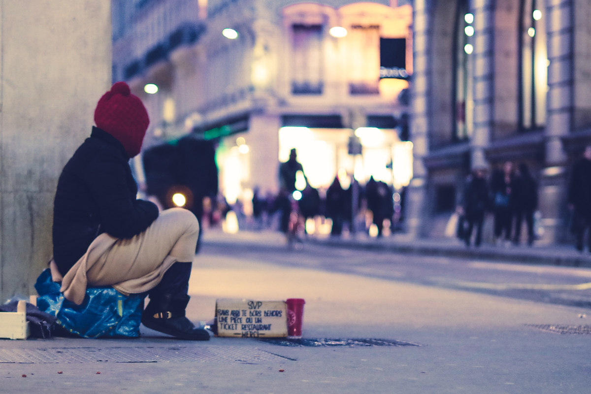 Alone and isolated on busy street