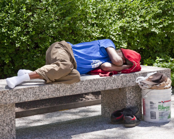 Man sleeping on a bench