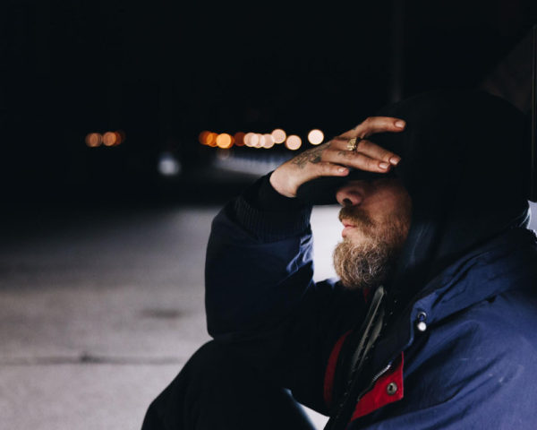 Man holding his head frustrated