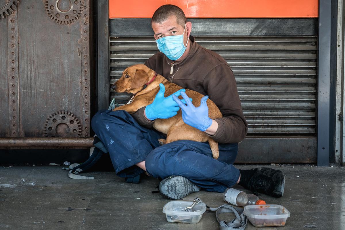 homeless man wears mask