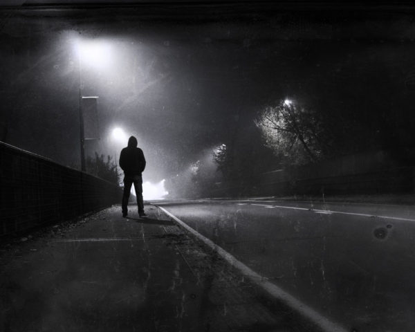 man disappearing into the night