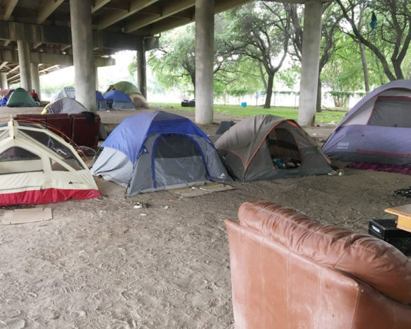Freeway encampment for homeless people