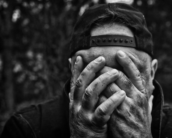 Man suffering from Mental Illness