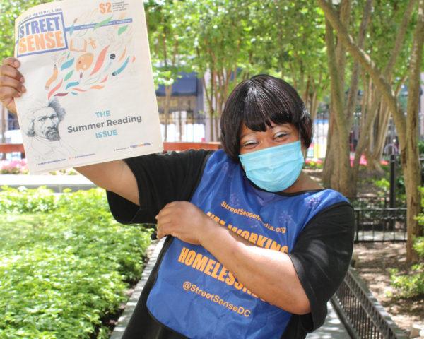 Street Sense Vendor shows the paper