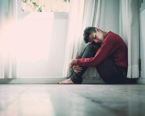 person sitting on floor, mental struggles