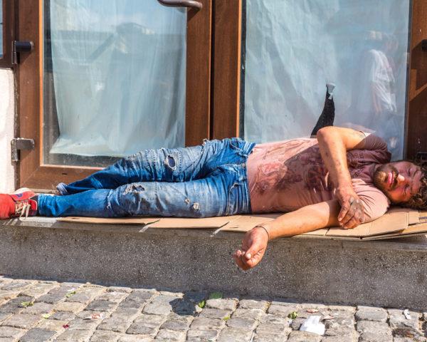 Man sleeping on stoop in summer heat