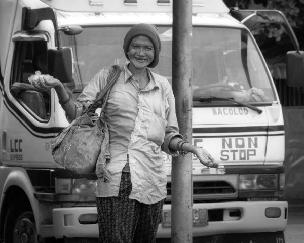happy homeless woman