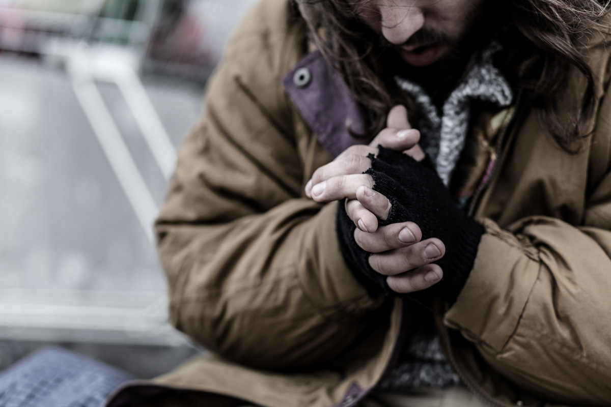 homeless man risks hypothermia in cold