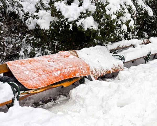 rough sleeper sleeping in snow