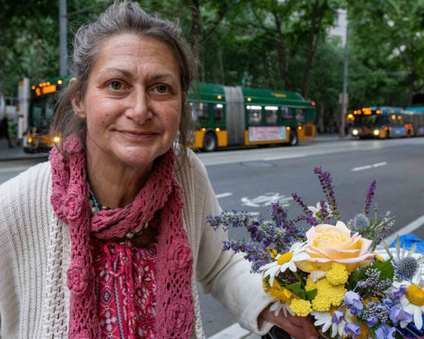 homeless woman with flowers