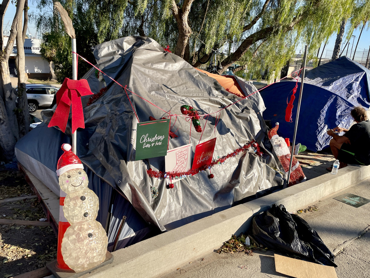 Christmas decorations on homeless person's tent