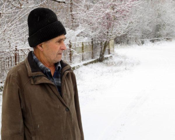 homeless elderly man in winter