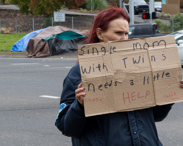 humanitarian crisis - homeless mother asks for help