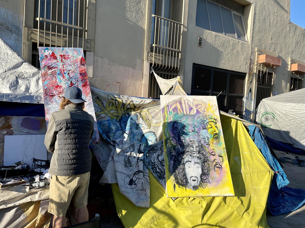 Homeless man in Venice Beach painting