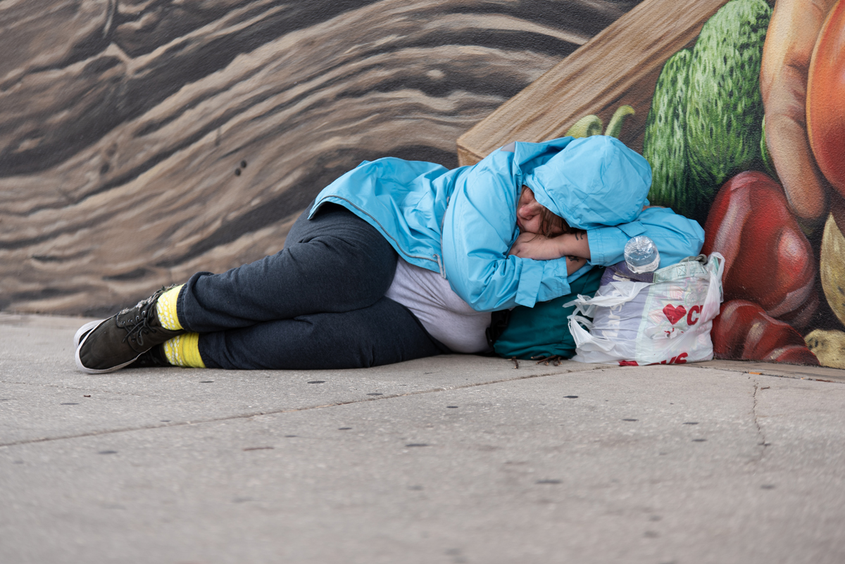 homeless woman sleeping on street