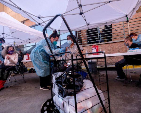 homeless people receiving vaccines