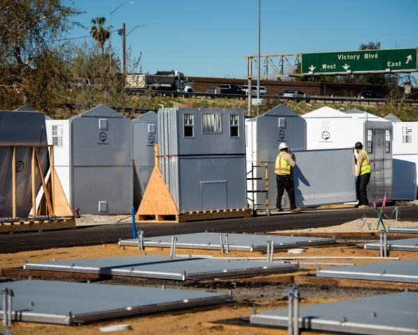 pallet shelter homes being constructed