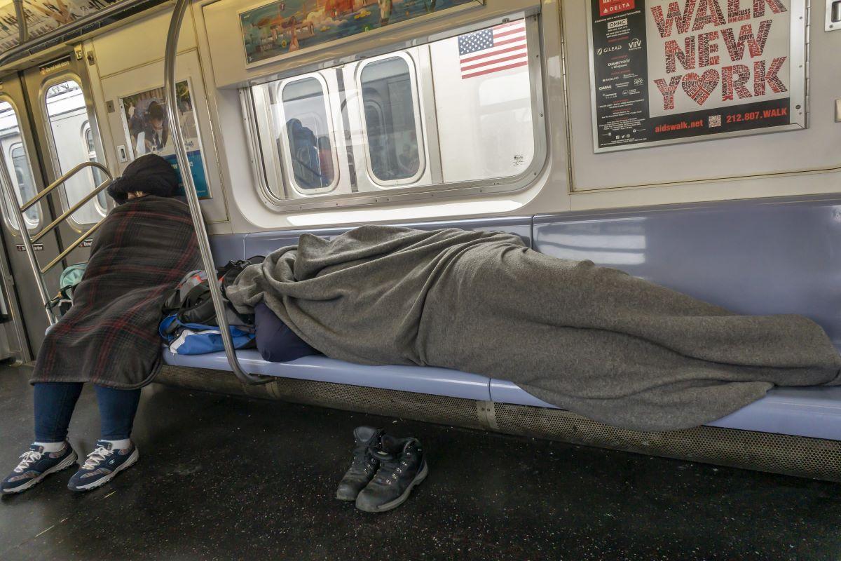 homeless people sleeping on subway
