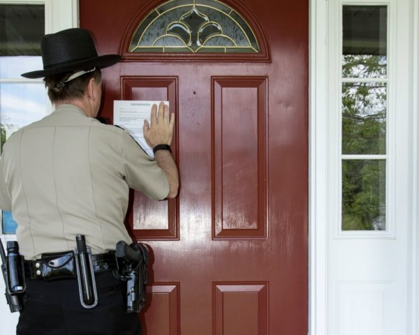 law enforcement placing eviction notice